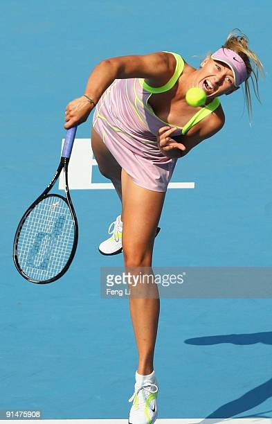 Maria Sharapova of Russia serves a shot against Victoria Azarenka of Belarus in her first round match during day five of the 2009 China Open at the...