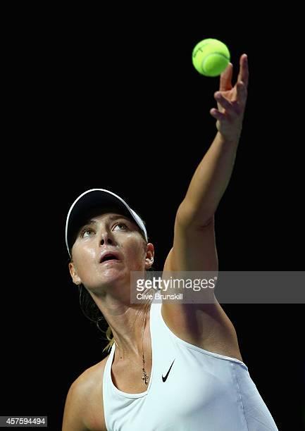 Maria Sharapova of Russia serves against Caroline Wozniacki of Denmark in their round robin match during the BNP Paribas WTA Finals at Singapore...