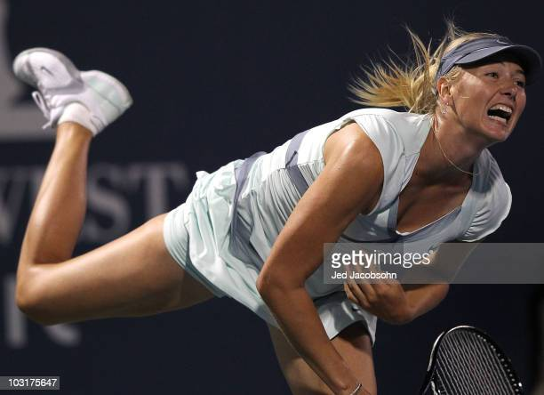 Maria Sharapova of Russia serves against Elena Dementieva of Russia during the quarterfinals of the Bank of the West Classic at Stanford University...