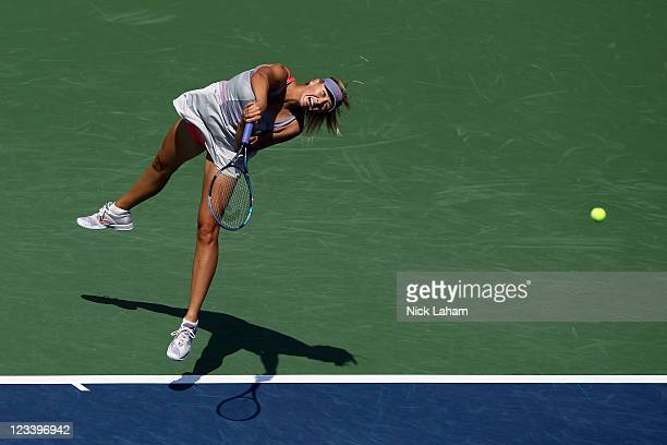 Maria Sharapova of Russia serves against Flavia Pennetta of Italy during Day Five of the 2011 US Open at the USTA Billie Jean King National Tennis...