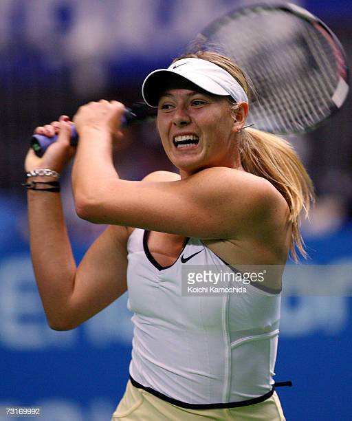 Maria Sharapova of Russia serves against Francesca Schiavone of Italy during day three of the Toray Pan Pacific Tournament at the Tokyo Metropolitan...