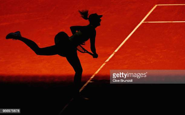 Maria Sharapova of Russia serves against Kiki Bertens of the Netherlands in their quarter final match during day six of the Mutua Madrid Open tennis...