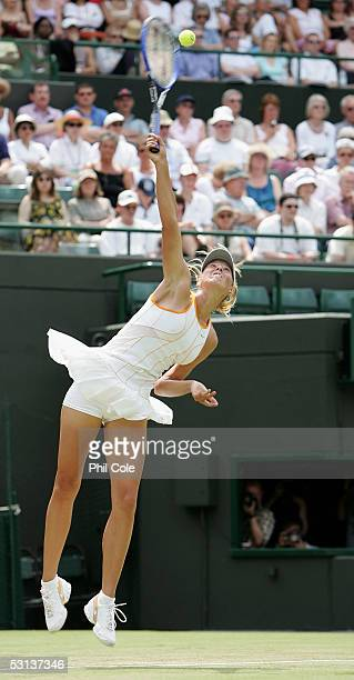 Maria Sharapova of Russia serves against Sesil Karatancheva of Bulgaria during the fourth day of the Wimbledon Lawn Tennis Championship on June 23...
