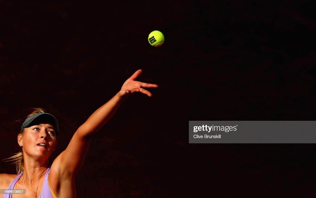 Maria Sharapova of Russia serves against Simona Halep of Romania in their final match during day nine of the Mutua Madrid Open tennis tournament at the Caja Magica on May 11, 2014 in Madrid, Spain.