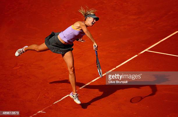 Maria Sharapova of Russia serves against Simona Halep of Romania in their final match during day nine of the Mutua Madrid Open tennis tournament at...