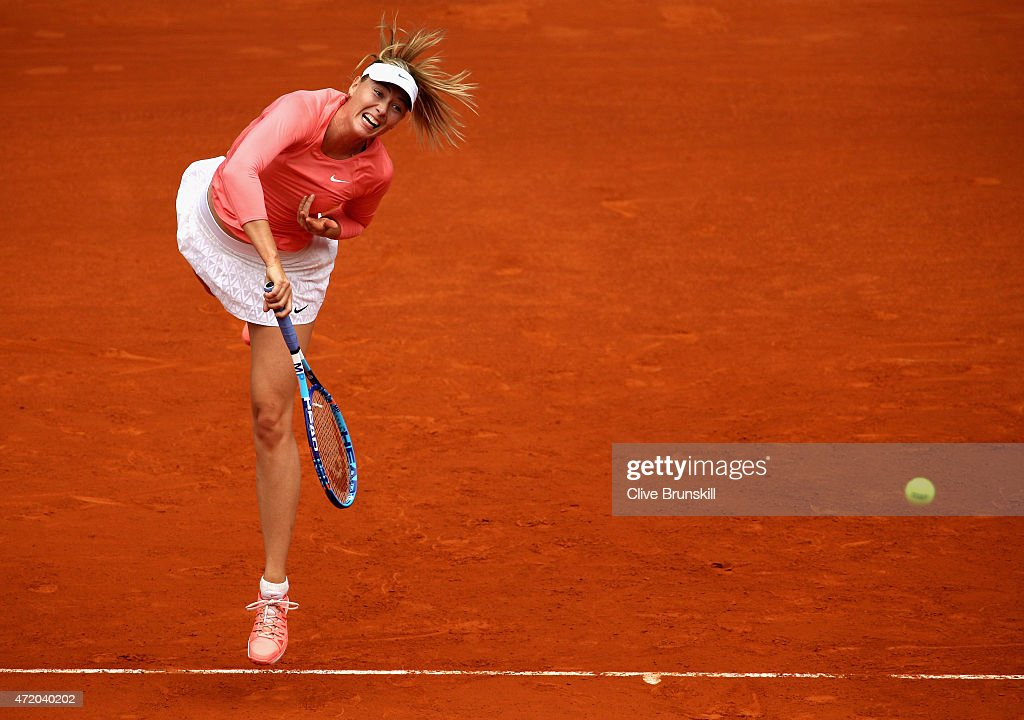 Maria Sharapova of Russia serves against Timea Bacsinszky of Switzerland in their first round match during day two of the Mutua Madrid Open tennis tournament at the Caja Magica on May 3, 2015 in Madrid, Spain.