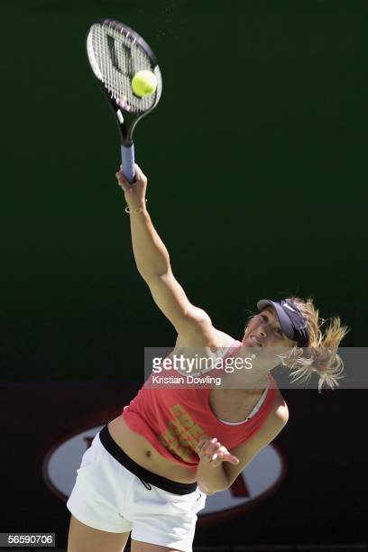 Maria Sharapova of Russia serves during a practice session prior to the Australian Open at Melbourne Park January 14 2006 in Melbourne Australia