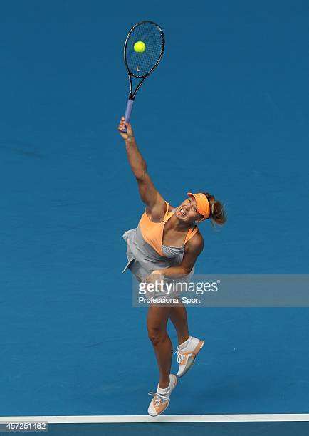 Maria Sharapova of Russia serves during her first round match against Tamarine Tanasugarn of Thailand during day one of the 2011 Australian Open at...