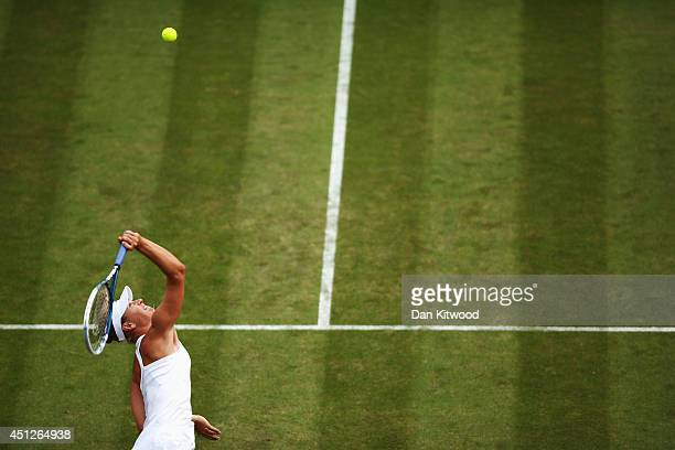 Maria Sharapova of Russia serves during her Ladies' Singles second round match against Timea Bacsinszky of Switzerland on day four of the Wimbledon...