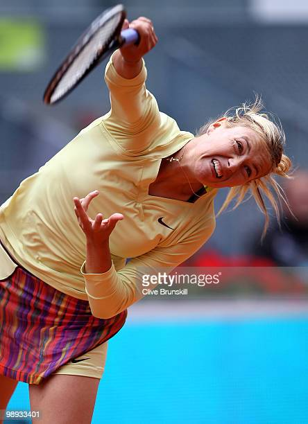 Maria Sharapova of Russia serves during her straight sets defeat by Lucie Safarova of Czech Republic in their first round match during the Mutua...