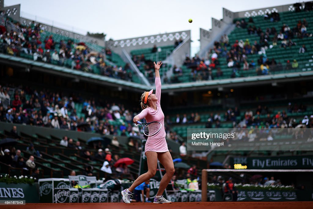 Maria Sharapova of Russia serves during her women's singles match against Tsvetana Pironkova of Bulgaria on day four of the French Open at Roland Garros on May 28, 2014 in Paris, France.