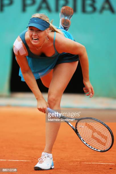 Maria Sharapova of Russia serves during her Women's Singles Second Round match against Nadia Petrova of Russia on day four of the French Open at...