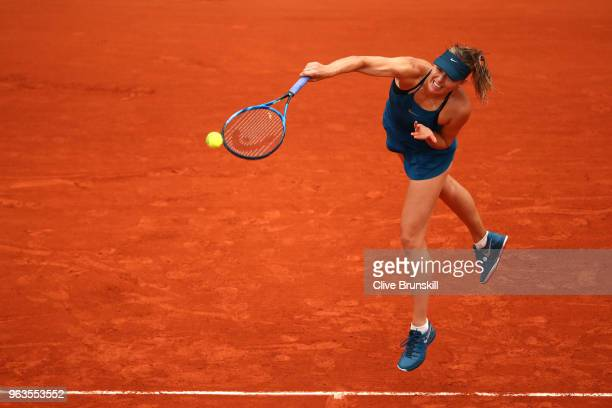 Maria Sharapova of Russia serves during the ladies singles first round match against Richel Hogenkamp of the Netherlands during day three of the 2018...