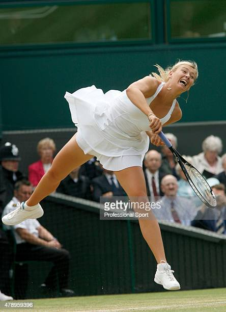 Maria Sharapova of Russia serves during the Women's Singles fourth round match against Venus Williams of USA during day nine of the Wimbledon Lawn...