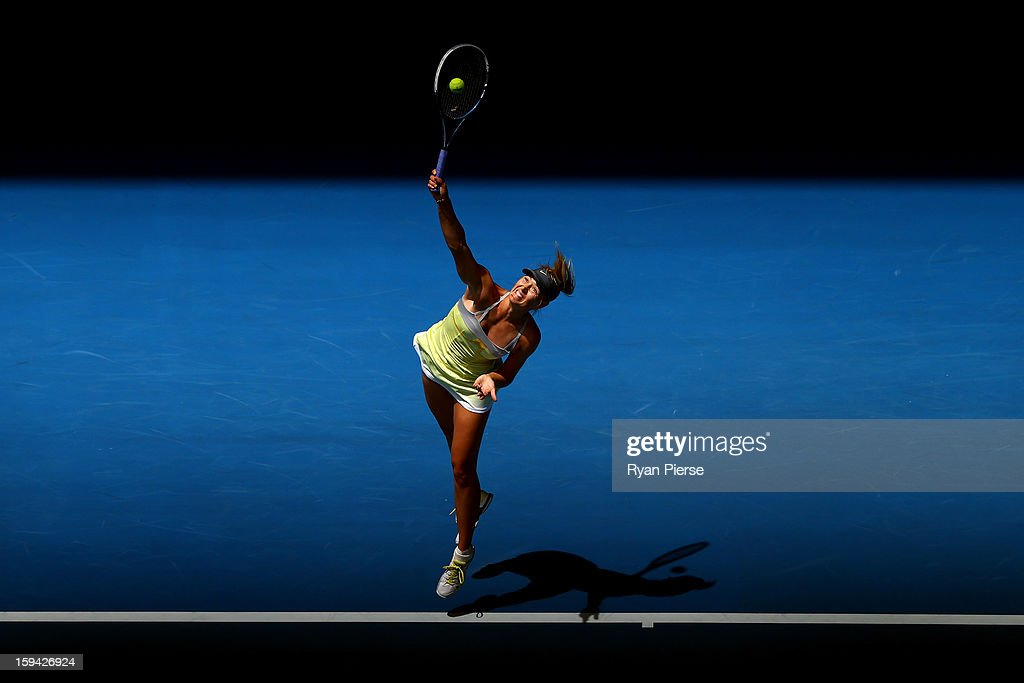 Maria Sharapova of Russia serves in her first round match against Olga Puchkova of Russia during day one of the 2013 Australian Open at Melbourne Park on January 14, 2013 in Melbourne, Australia.