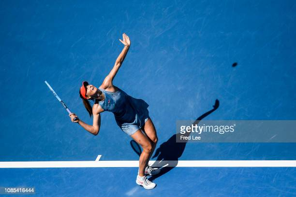 Maria Sharapova of Russia serves in her fourth round match against Ashleigh Barty of Australia during day seven of the 2019 Australian Open at...