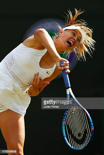 Maria Sharapova of Russia serves in her Ladies' Singles Third Round match against IrinaCamelia Begu of Romania during day five of the Wimbledon Lawn...