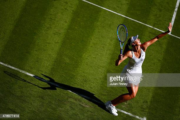 Maria Sharapova of Russia serves in her Ladies's Singles first round match against Johanna Konta of Great Britain during day one of the Wimbledon...