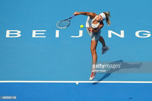 Maria Sharapova of Russia serves in her match against Elina Scitolina of Ukraine during day four of of the China Open at the National Tennis Center...