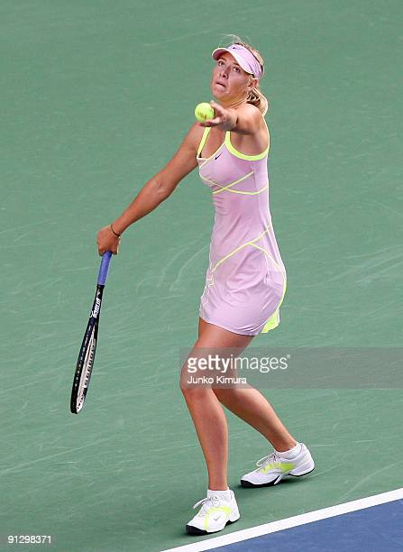 Maria Sharapova of Russia serves in her match against Iveta Benesova of the Czech Republic during day five of the Toray Pan Pacific Open Tennis...
