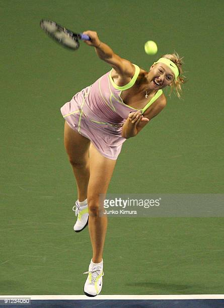 Maria Sharapova of Russia serves in her match against Samantha Stosur of Australia during day three of the Toray Pan Pacific Open Tennis tournament...