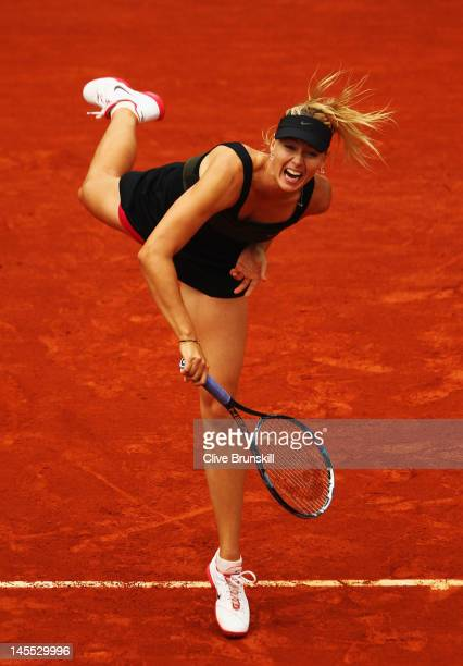 Maria Sharapova of Russia serves in her women's singles second round match against Ayumi Morita of Japan during day 6 of the French Open at Roland...