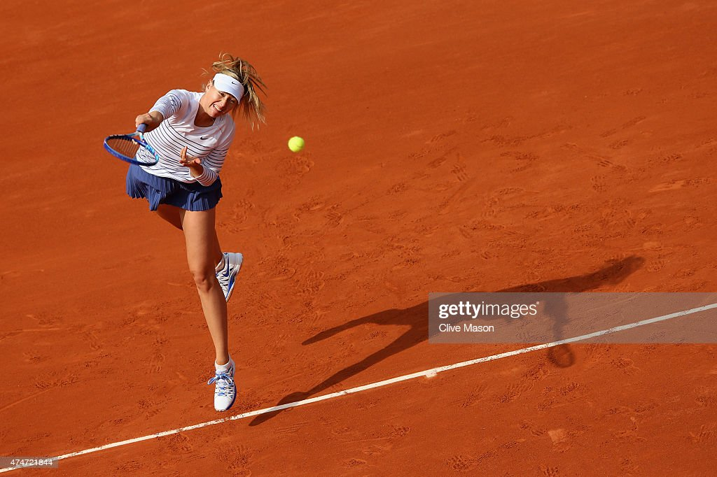 Maria Sharapova of Russia serves in Women's Singles match against Kaia Kanepi of Estonia on day two of the 2015 French Open at Roland Garros on May 25, 2015 in Paris, France.