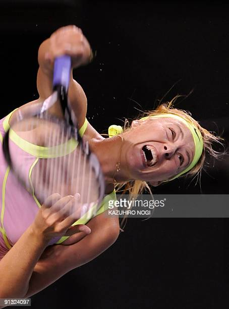 Maria Sharapova of Russia serves the ball against Agnieszka Radwanska of Poland during their women's singles semifinal match in the Pan Pacific Open...