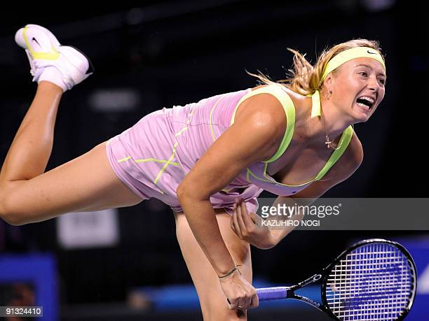 Maria Sharapova of Russia serves the ball against Agnieszka Radwanska of Poland during their women's singles semifinal match at the Pan Pacific Open...