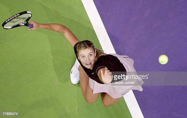 Maria Sharapova of Russia serves the ball to Anna Ivanovic of Serbia during day four of the Sony Ericsson WTA Tour Championships at the Madrid Arena...