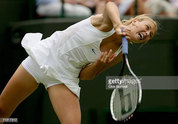 Maria Sharapova of Russia serves to Anna Smashnova of Israel during day three of the Wimbledon Lawn Tennis Championships at the All England Lawn...
