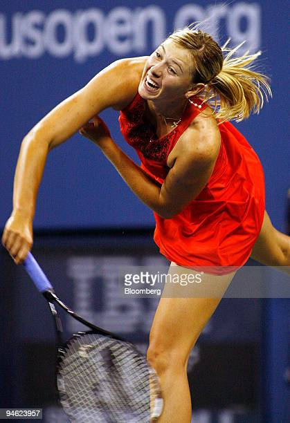 Maria Sharapova of Russia serves to Casey Dellacqua of Australia during the US Open at the Billie Jean King Tennis Center in New York on Thursday Aug...