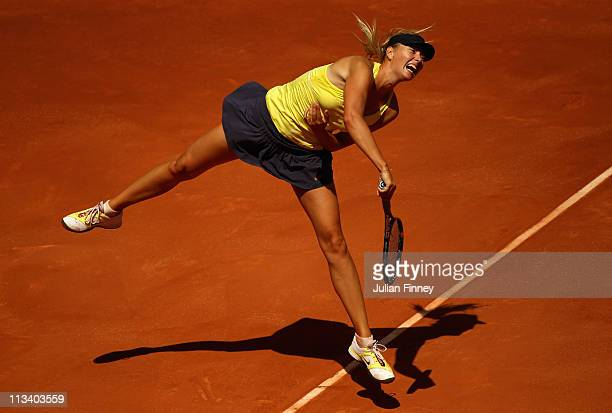 Maria Sharapova of Russia serves to Ekaterina Makarova of Russia during day three of the Mutua Madrilena Madrid Open Tennis on May 2 2011 in Madrid...