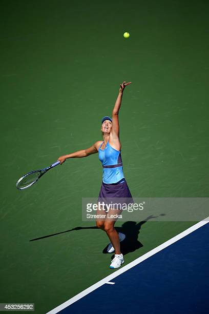 Maria Sharapova of Russia serves to Garbine Muguruza of Spain during the Rogers Cup at Uniprix Stadium on August 6 2014 in Montreal Canada