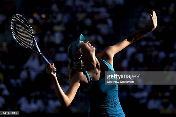 Maria Sharapova of Russia serves to Maria Kirilenko of Russia during the BNP Paribas Open at the Indian Wells Tennis Garden on March 15, 2012 in...
