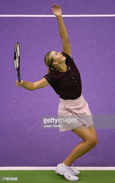 Maria Sharapova of Russia serves to Svetlana Kuznetsova of Russia during day three of the Sony Ericsson WTA Tour Championships at the Madrid Arena...