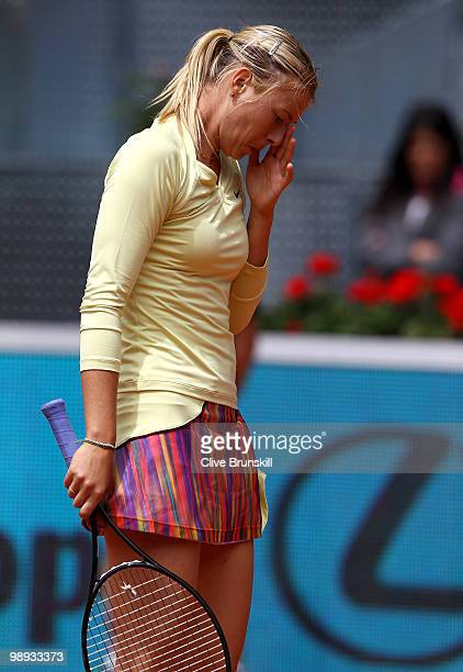 Maria Sharapova of Russia shows her dejection during her straight sets defeat by Lucie Safarova of Czech Republic in their first round match during...