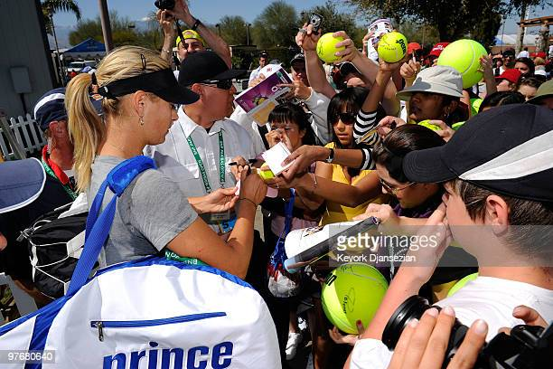 Maria Sharapova of Russia signs autographs after her practice during the BNP Paribas Open on March 13 2010 in Indian Wells California
