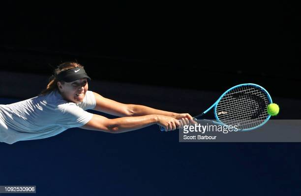 Maria Sharapova of Russia stretches for a backhand shot during a practice session ahead of the 2019 Australian Open at Melbourne Park on January 11...