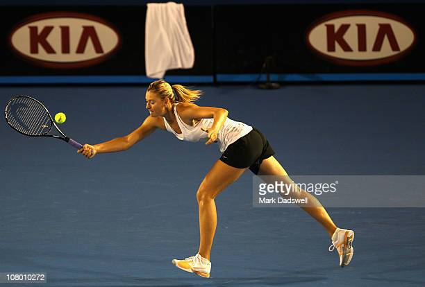 Maria Sharapova of Russia stretches for a forehand during a practice session ahead of the 2011 Australian Open at Melbourne Park on January 13 2011...