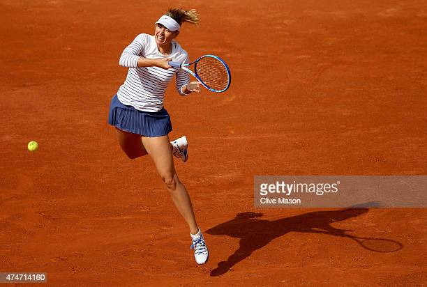 Maria Sharapova of Russia stretches for a forehand in Women's Singles match against Kaia Kanepi of Estonia on day two of the 2015 French Open at...