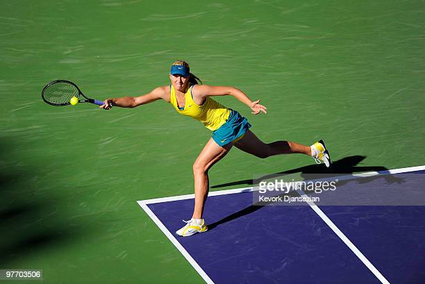 Maria Sharapova of Russia stretches for a return against Jie Zheng of China during the BNP Paribas Open on March 14 2010 in Indian Wells California