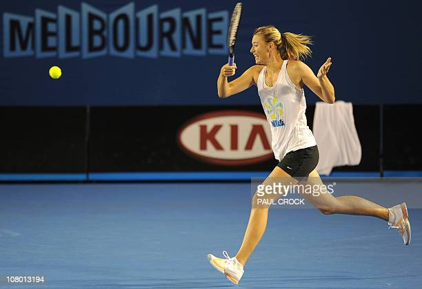 Maria Sharapova of Russia stretches to make a return during a practice session for the upcoming Australian Open tennis tournament in Melbourne on...