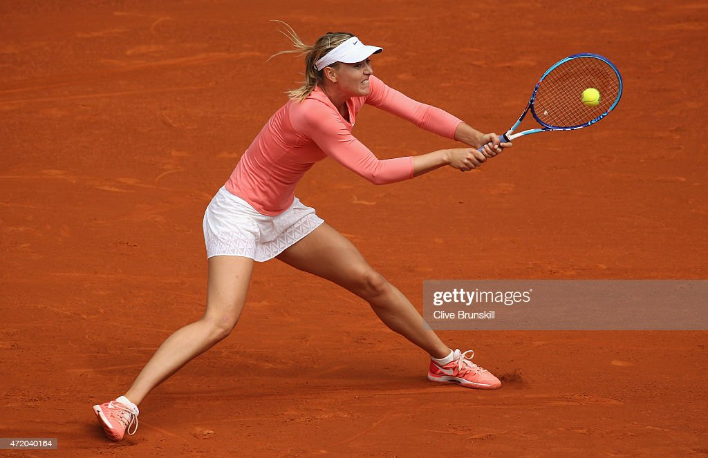 Maria Sharapova of Russia stretches to play a backhand against Timea Bacsinszky of Switzerland in their first round match during day two of the Mutua Madrid Open tennis tournament at the Caja Magica on May 3, 2015 in Madrid, Spain.