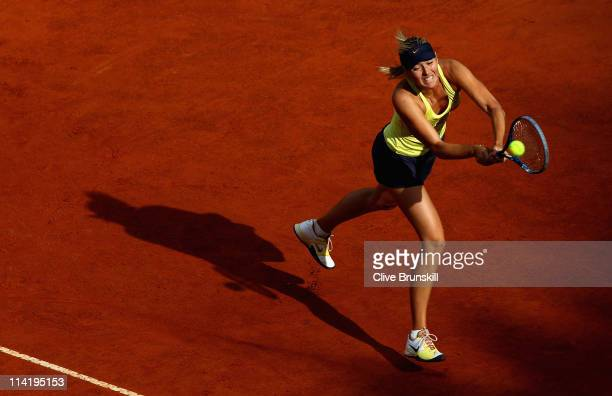 Maria Sharapova of Russia stretches to play a backhand during the final against Samantha Stosur of Australia during day eight of the Internazoinali...