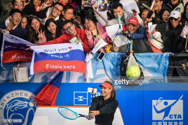TOPSHOT Maria Sharapova of Russia takes a selfie with fans after her women's singles first round match against Timea Bacsinszky of Switzerland at the...