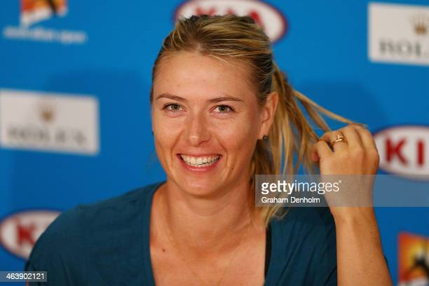 Maria Sharapova of Russia talks to the media after losing her fourth round match against Dominika Cibulkova of Slovakia during day eight of the 2014...
