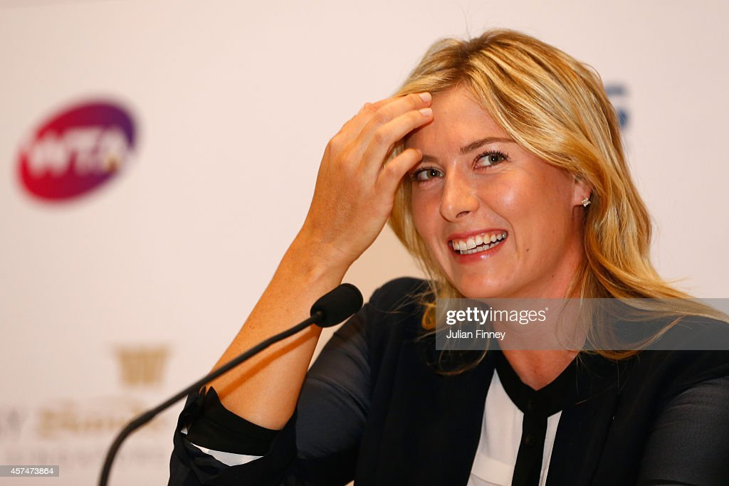 Maria Sharapova of Russia talks to the media during previews for the WTA Finals at the ArtScience Museum on October 19, 2014 in Singapore.