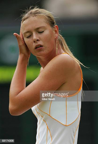 Maria Sharapova of Russia touches her hair against Venus Williams of USA during the tenth day of the Wimbledon Lawn Tennis Championship on June 30...
