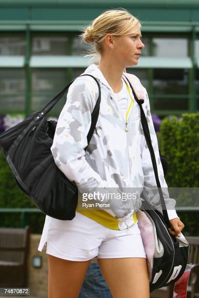 Maria Sharapova of Russia walks back from the practice courts during previews for the Wimbledon Lawn Tennis Championships at the All England Lawn...